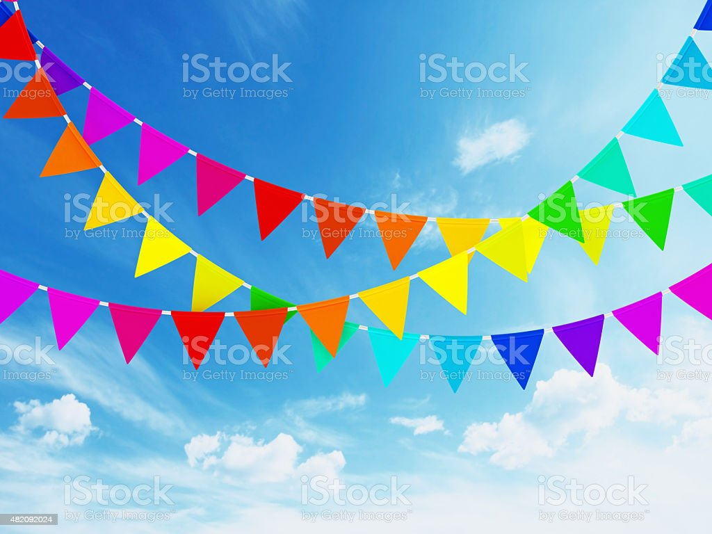 Colorful bunting flags on blue sky stock photo