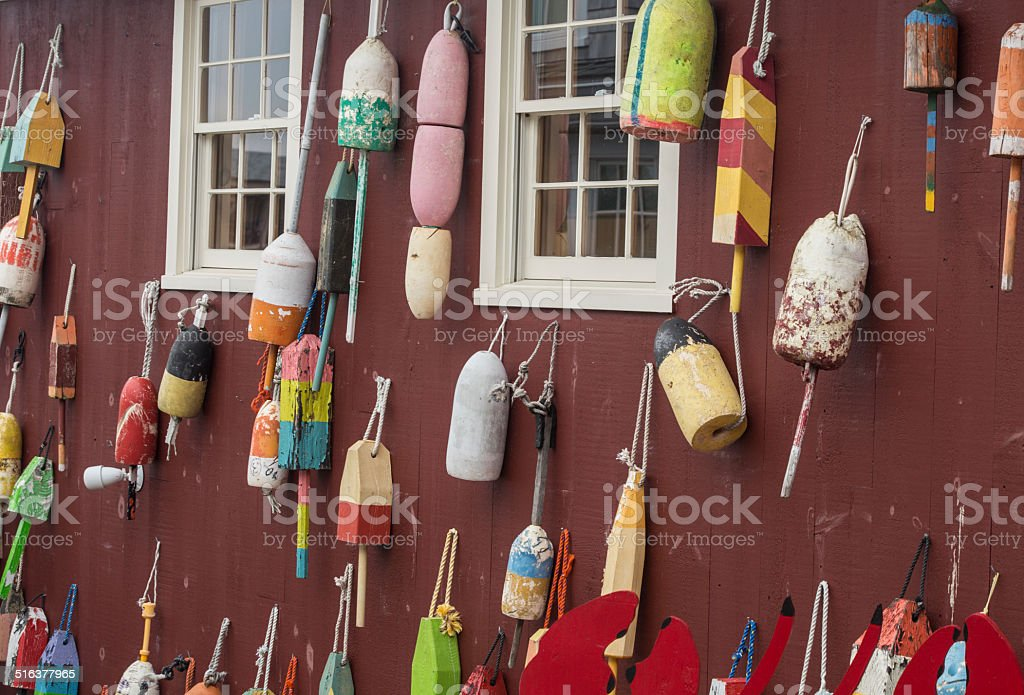 Colorful Buoys hanged on a red wall stock photo