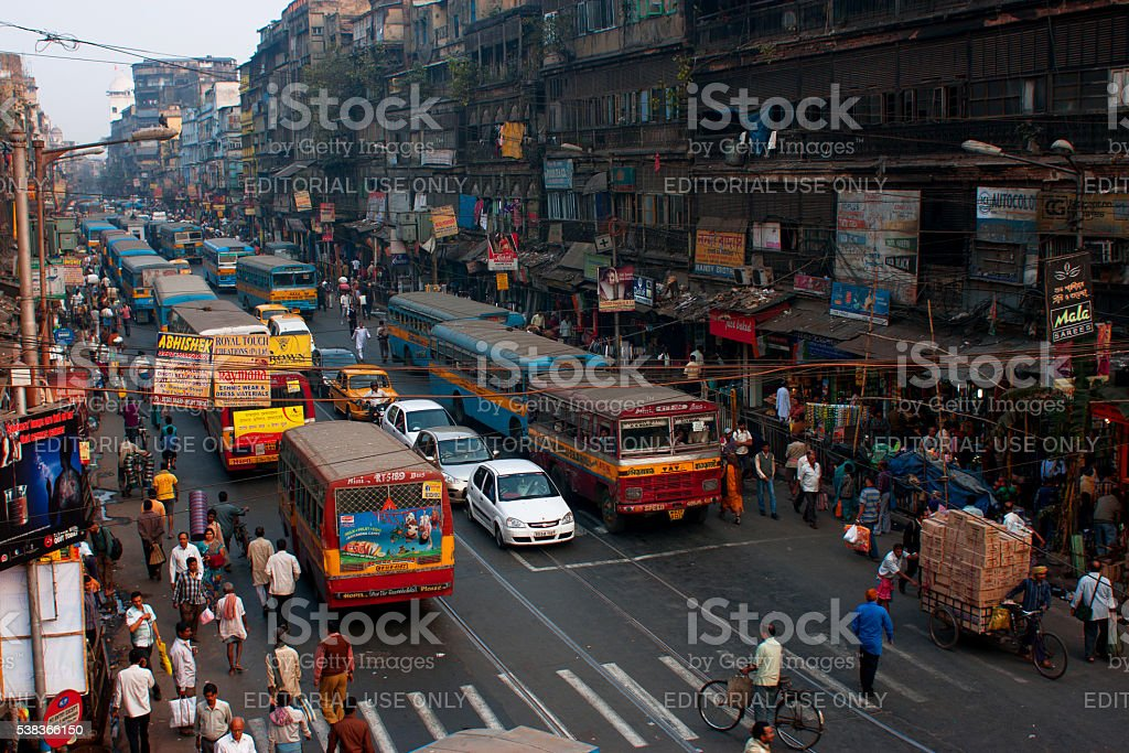 Colorful buses, cars and pedestrians move on the crowded street stock photo