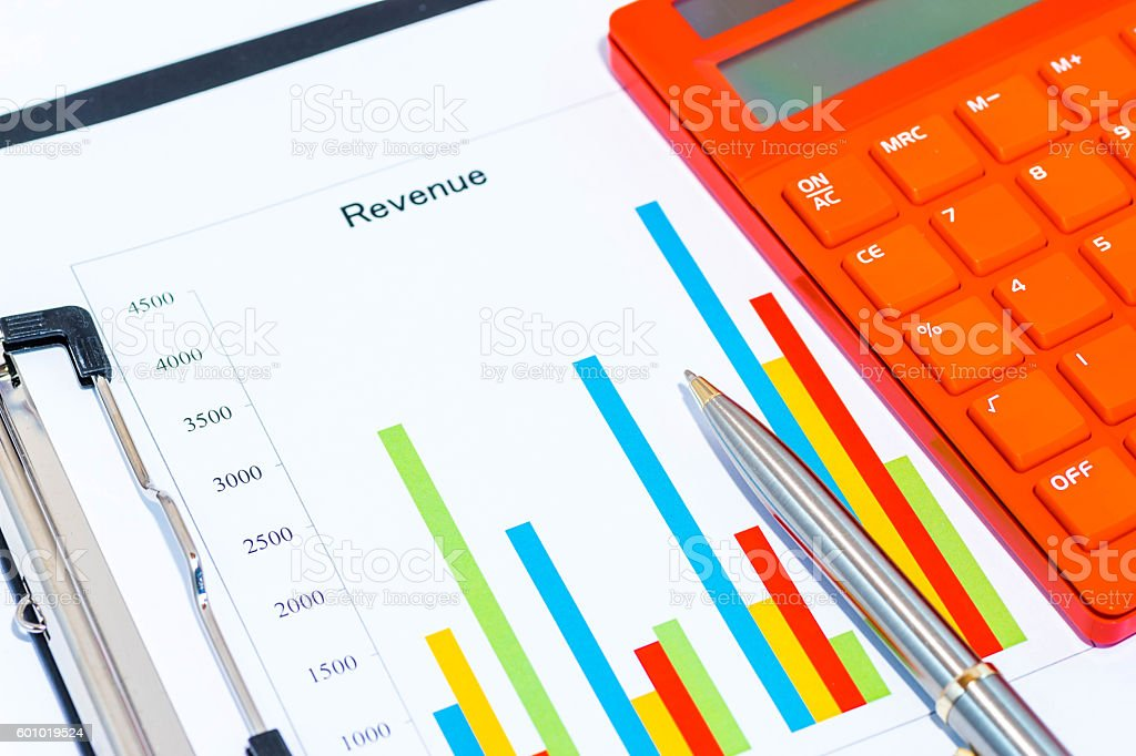 Colorful business charts and calculator with black clipboard stock photo