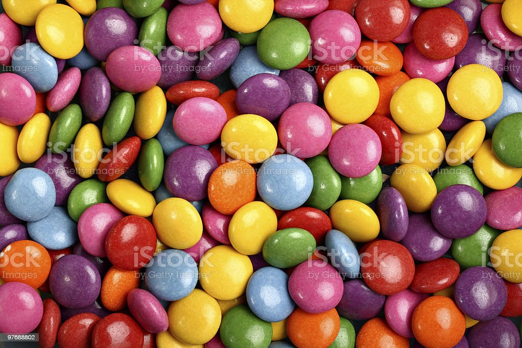 Colorful button shaped candies filled with chocolate stock photo