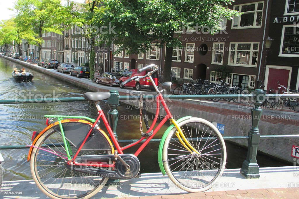 Colorful bycicle at Amsterdam Canal Bridge stock photo
