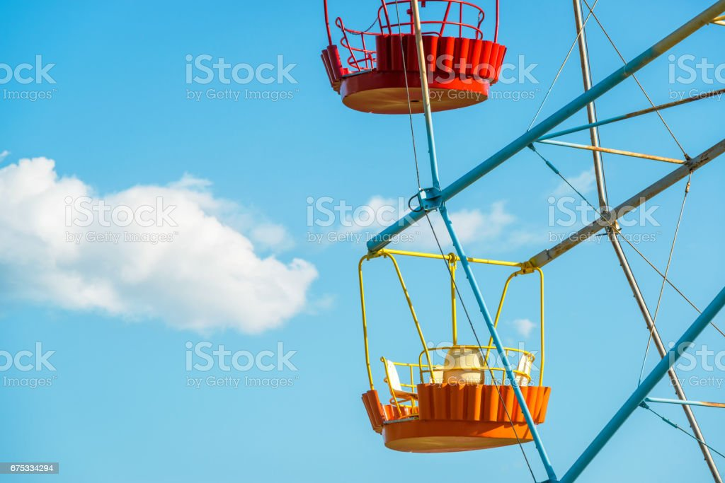 Colorful cabins of Ferris wheel stock photo