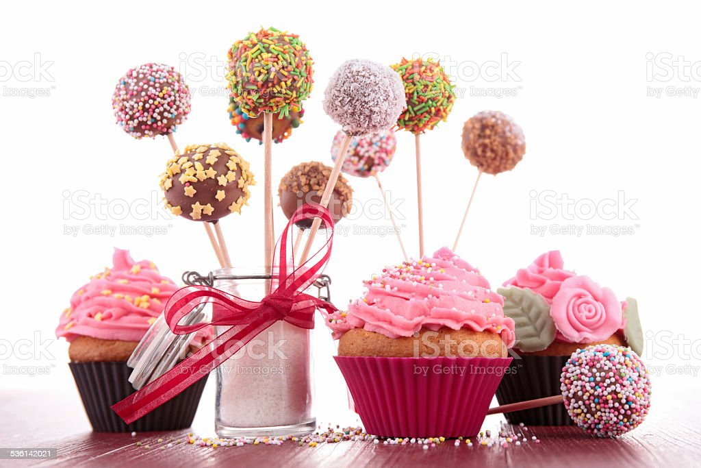 colorful cake pops and cupcake stock photo