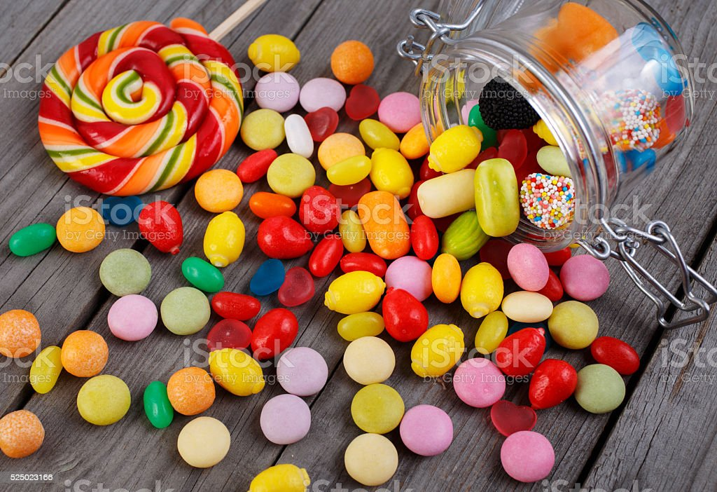 Colorful candies in jar stock photo