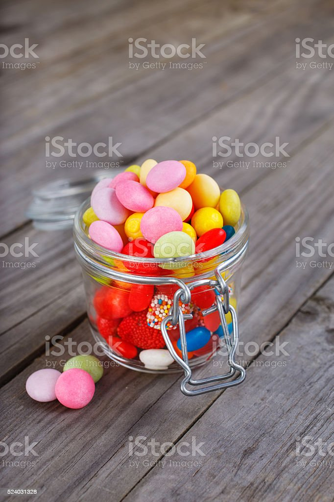 Colorful candies in small jar stock photo