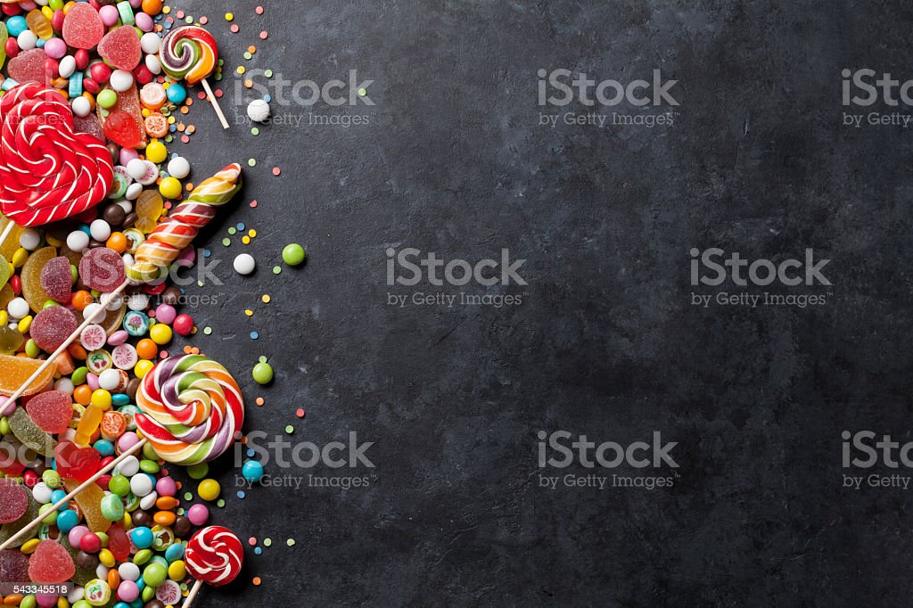 Colorful candies, jelly and marmalade over stone stock photo