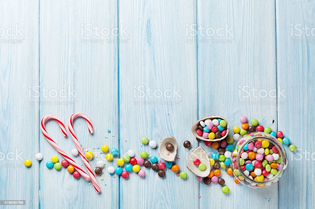 Colorful candies on wooden background stock photo