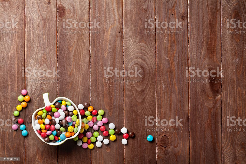 Colorful candies over wood stock photo