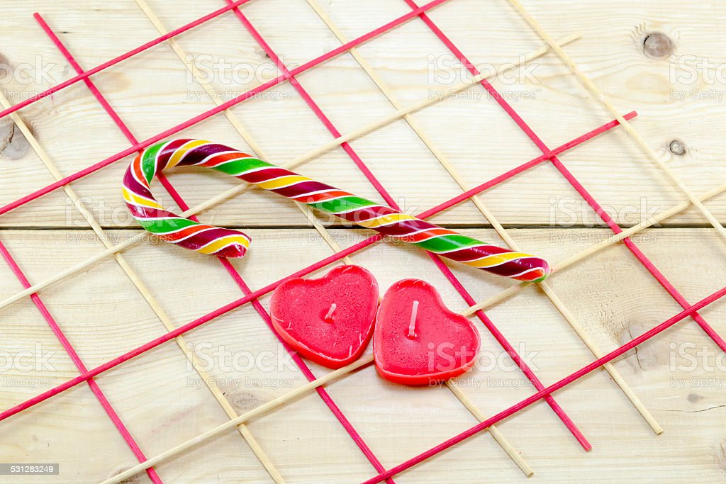 Colorful candy cane and heart shaped candles royalty-free stock photo