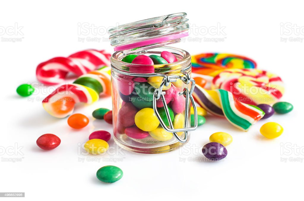 Colorful candy in a glass jar stock photo