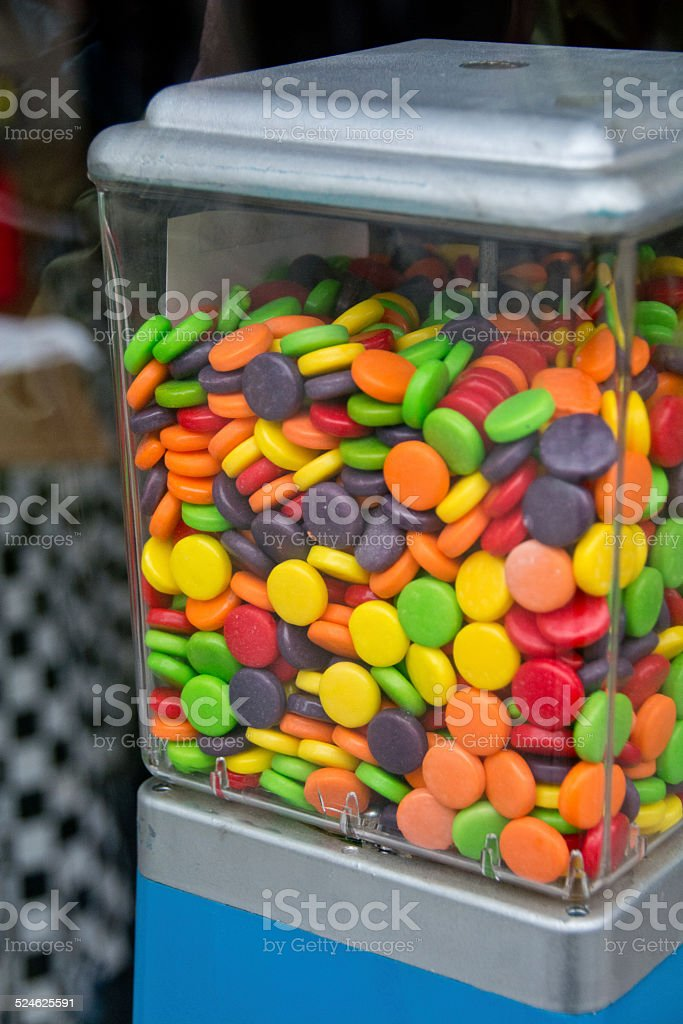 Colorful candy in a vending machine stock photo