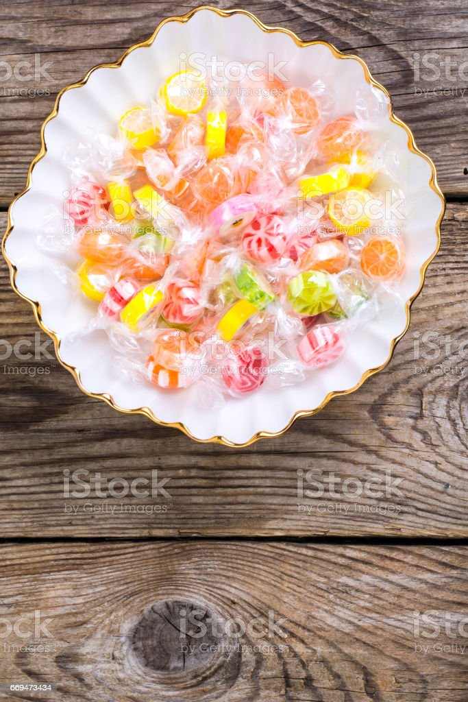Colorful candy in cellophane wrappers stock photo