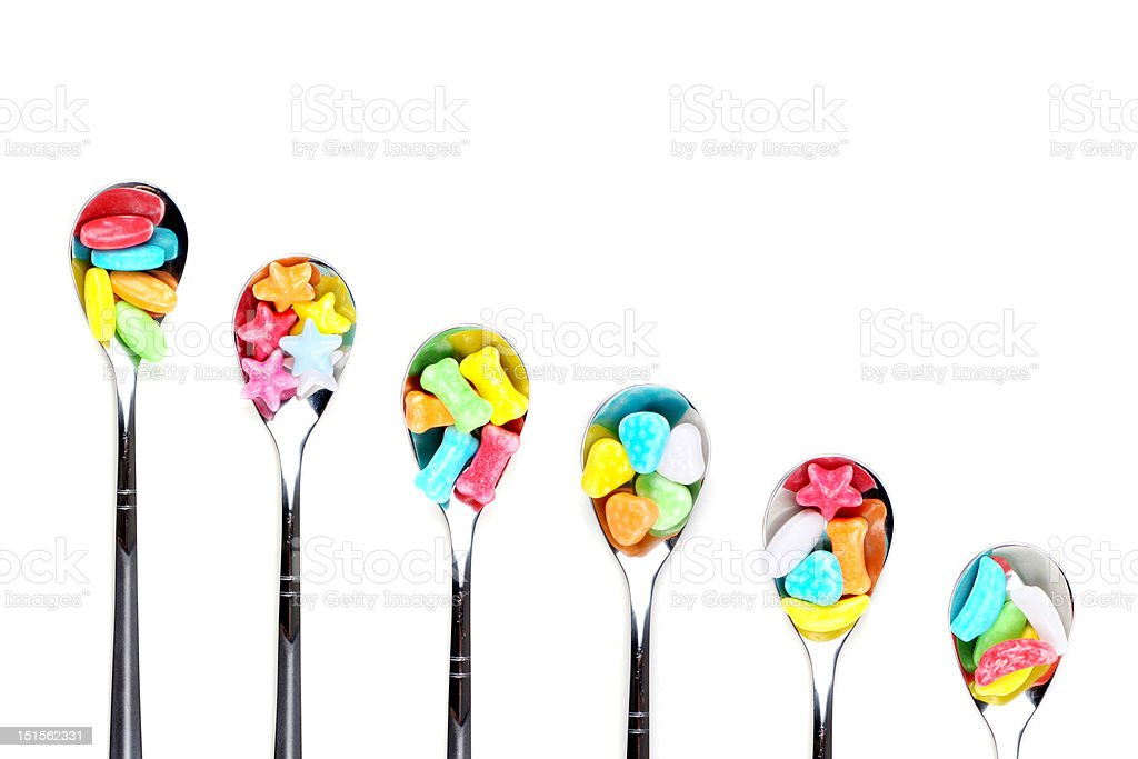 colorful candy with metal spoons royalty-free stock photo