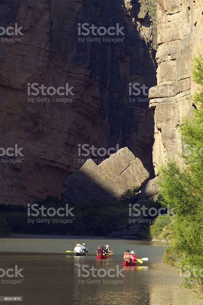 Colorful Canoers Heading into Santa Elena Canyon in Big Bend royalty-free stock photo
