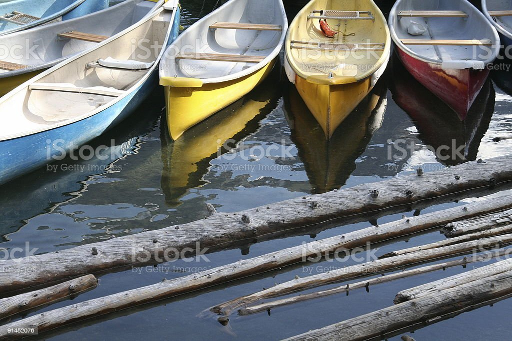 colorful canoes stock photo