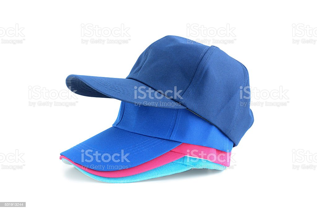 Colorful caps on white background stock photo