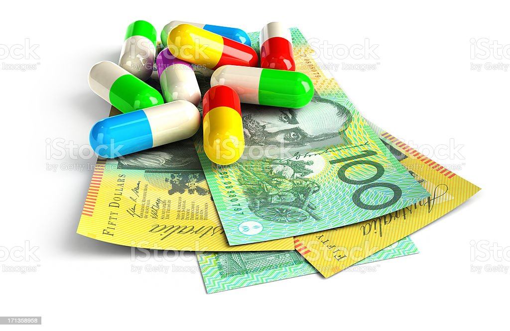 Colorful capsules on Australian Dollar notes stock photo