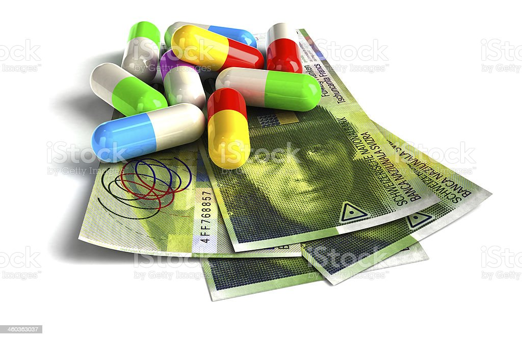 Colorful capsules on Swiss Franc notes. royalty-free stock photo