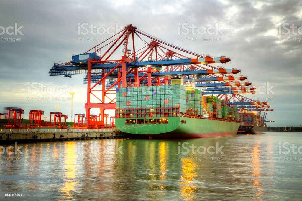 A colorful cargo ship docked in the harbor royalty-free stock photo
