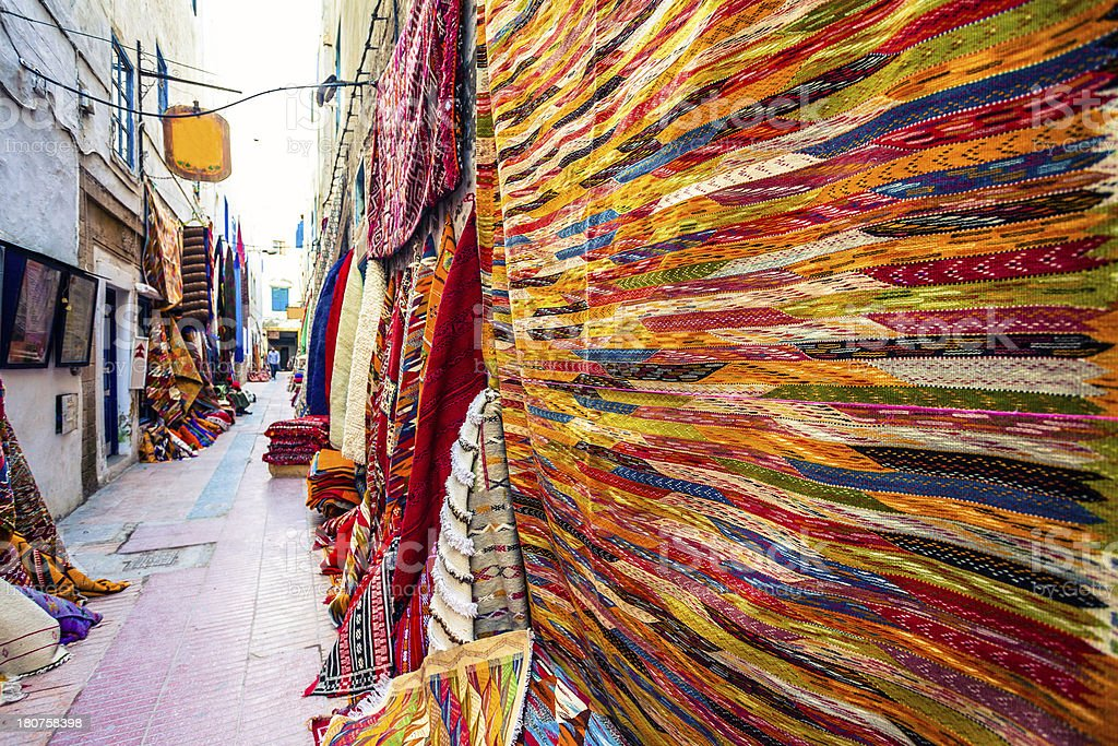 Colorful Carpets Shop in the Souk Market, Morocco royalty-free stock photo