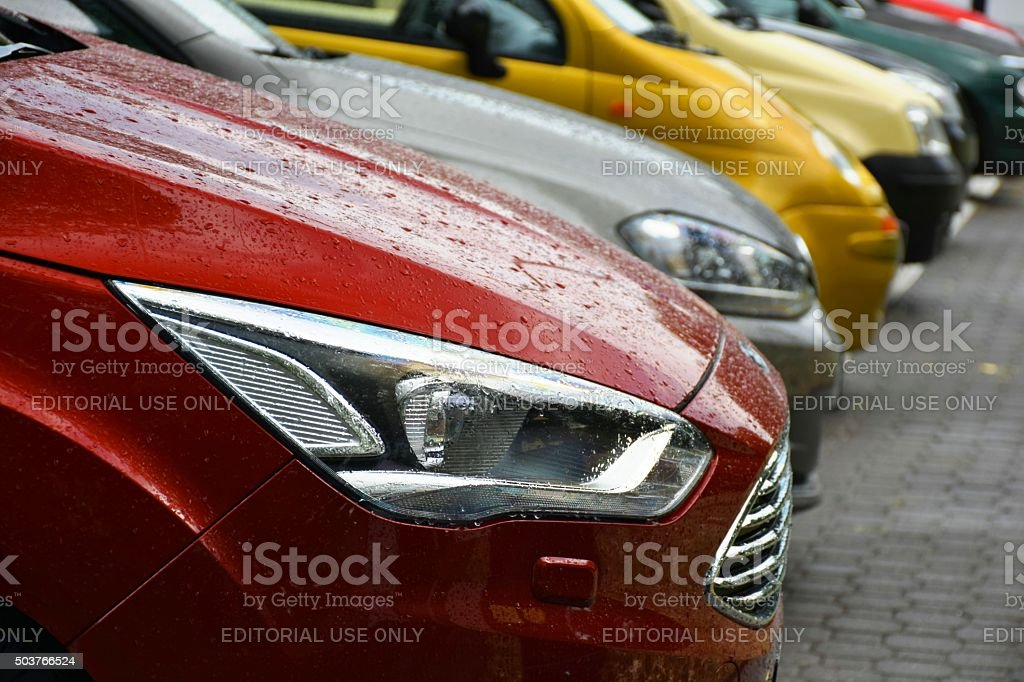 Colorful cars parked on the street stock photo