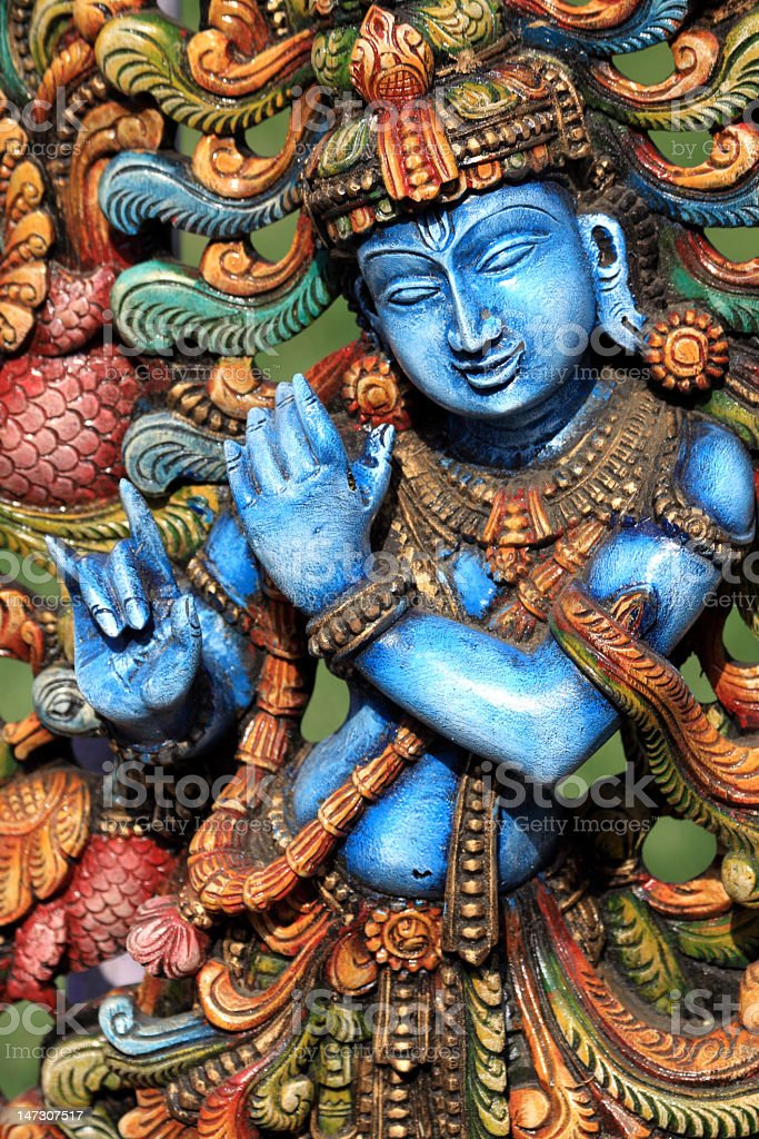 A colorful carving of Lord Krishna stock photo