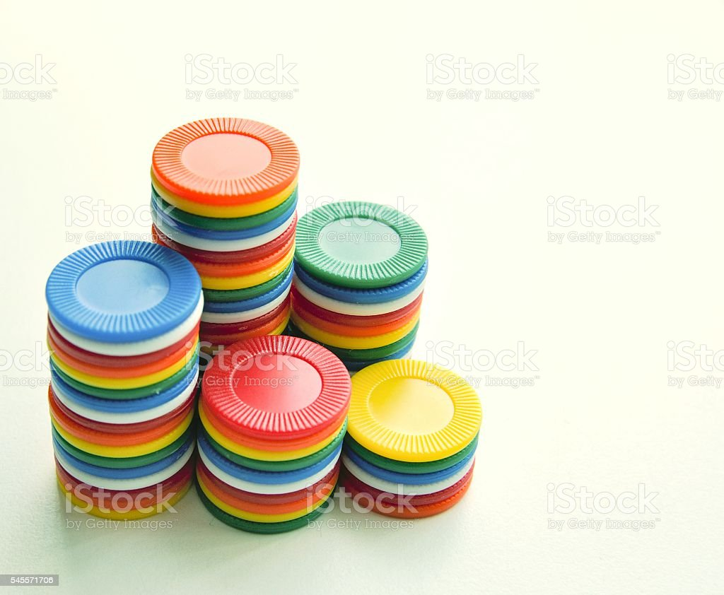 Colorful casino chips stacked in a corner foto de stock libre de derechos