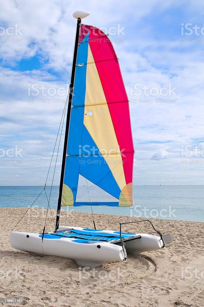 Colorful catamaran in the beach stock photo