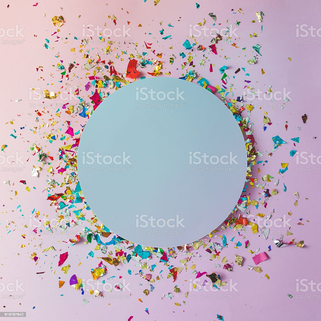 Colorful celebration background with party confetti on pink back stock photo
