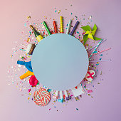 Colorful celebration background with various party confetti, bal