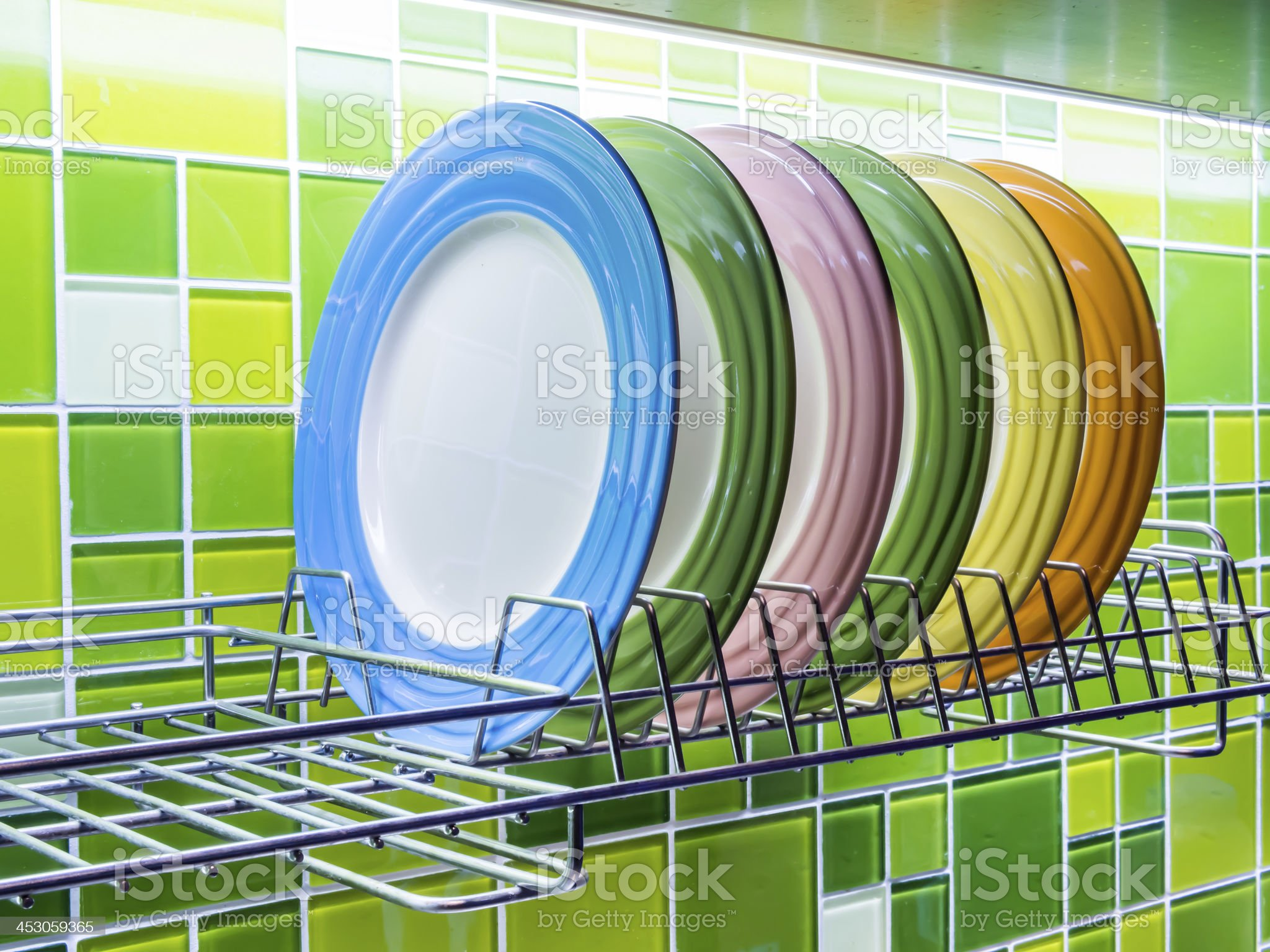 Colorful ceramic plates in modern kitchen royalty-free stock photo