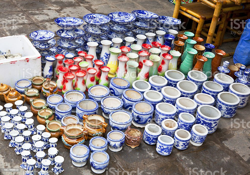 Colorful ceramics for sale on sidewalk in Vietnam. royalty-free stock photo