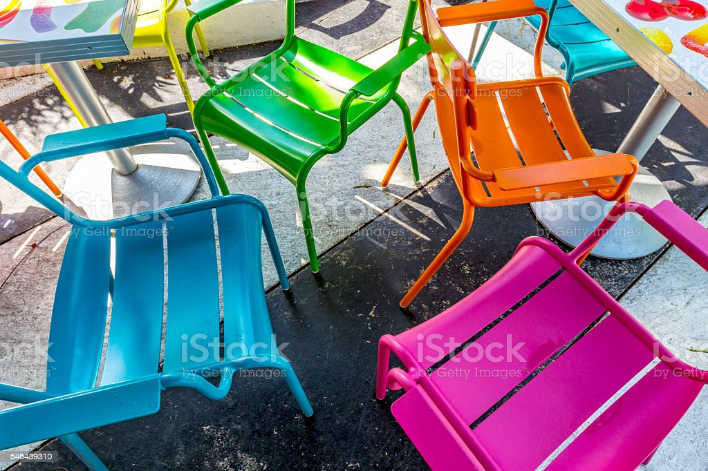 colorful chairs at an outdoor restaurant in Miami stock photo