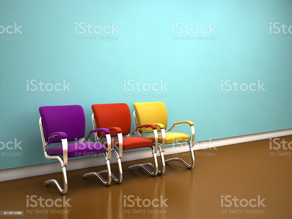 colorful chairs near blue wall stock photo