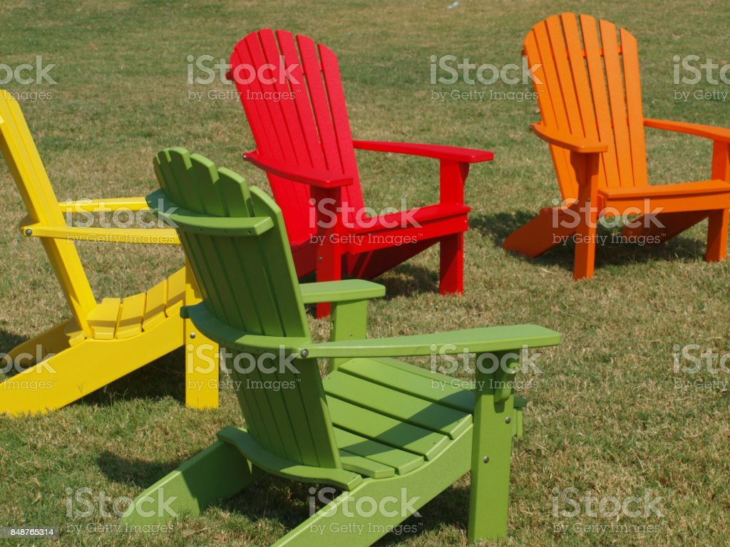 Colorful Chairs on a Lawn stock photo