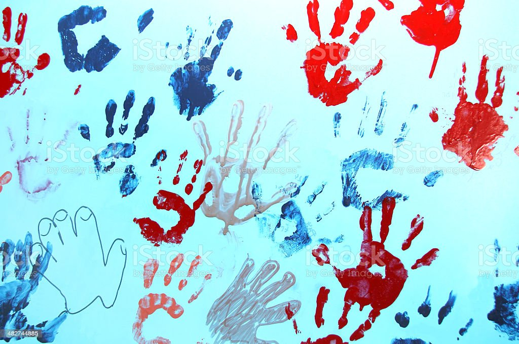 Colorful children hand print on a wall. stock photo