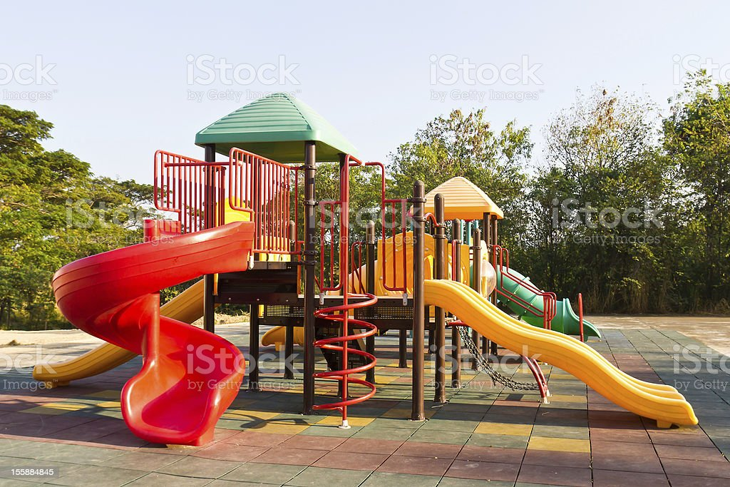 Colorful children playground in a park stock photo