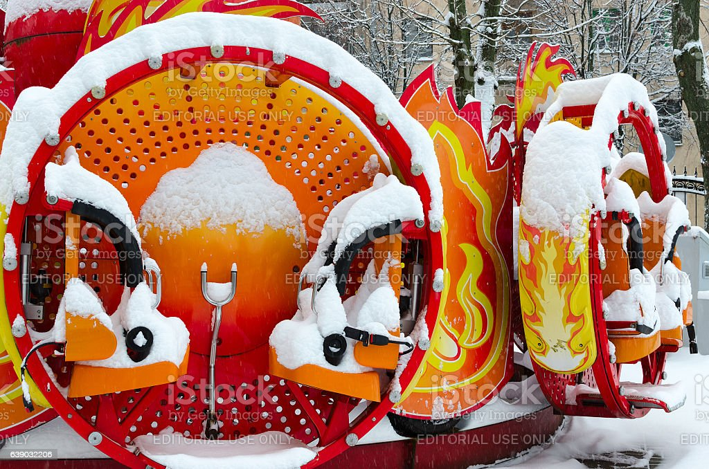 Colorful children's attraction covered by snow in winter park stock photo
