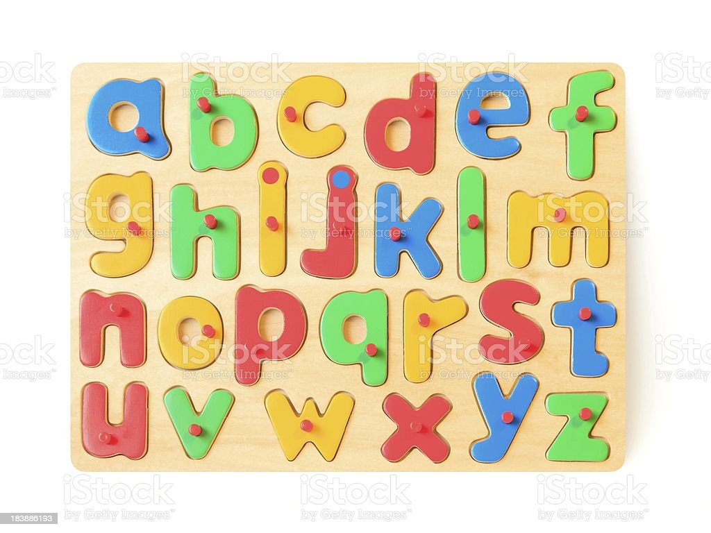Colorful childrens letter spelling toy puzzle on white stock photo
