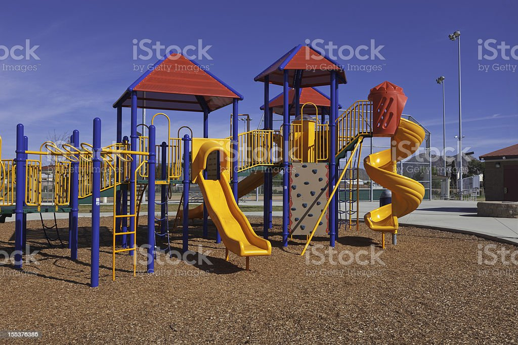 Colorful children's playground with multiple slides royalty-free stock photo