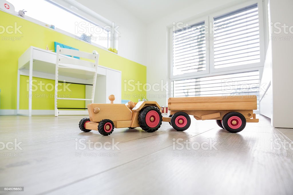Colorful Children's Playroom with toy in the foreground stock photo