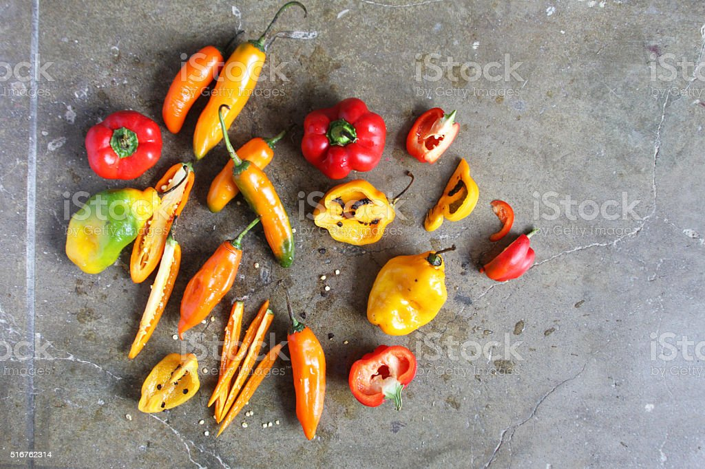 Colorful Chili Peppers on a Stone Slab stock photo