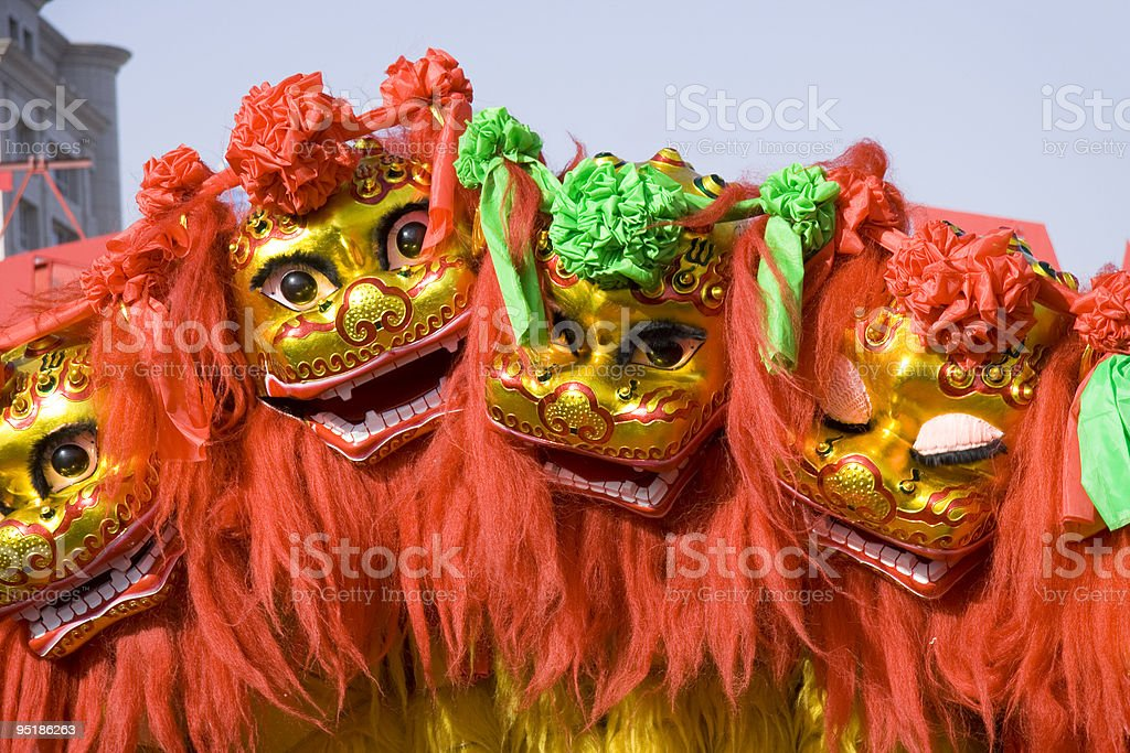 Colorful Chinese lion dancing and moving in the streets stock photo