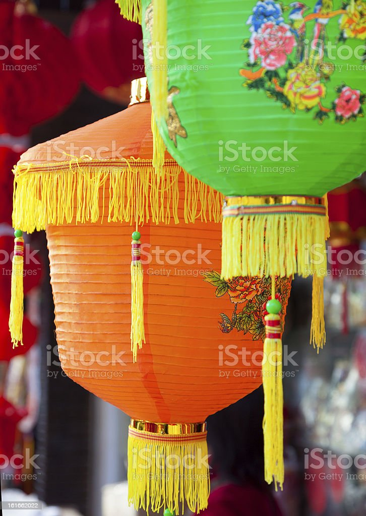 Colorful Chinese paper lanterns hanging in a street market royalty-free stock photo
