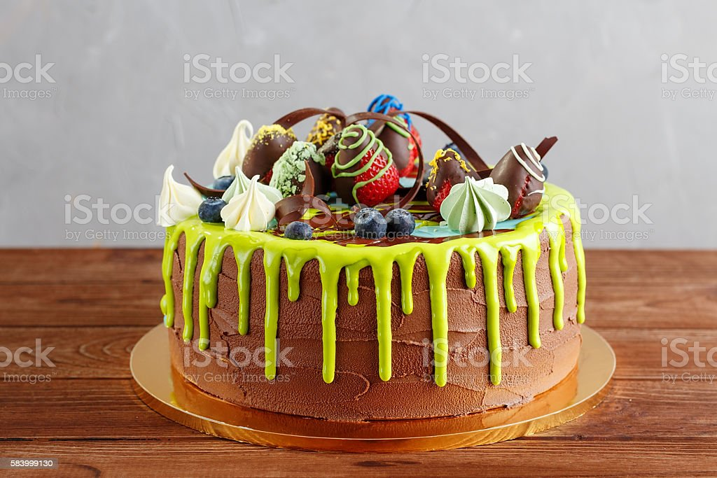 Colorful chocolate cake with fruit and glaze stock photo