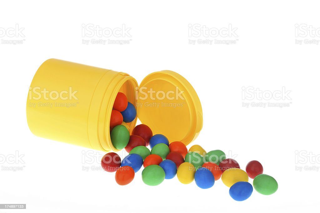 Colorful Chocolate-covered Peanuts slipping from a bottle royalty-free stock photo