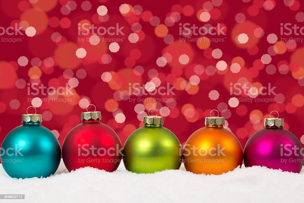 Colorful Christmas balls in a row background decoration with snow stock photo