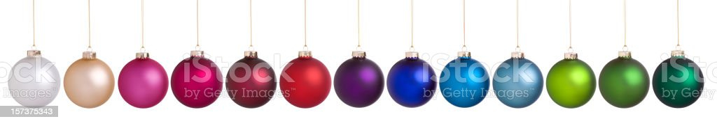 Colorful Christmas Baubles Hanging in a Row Isolated on White. stock photo