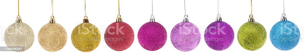 Colorful Christmas baubles in a row royalty-free stock photo